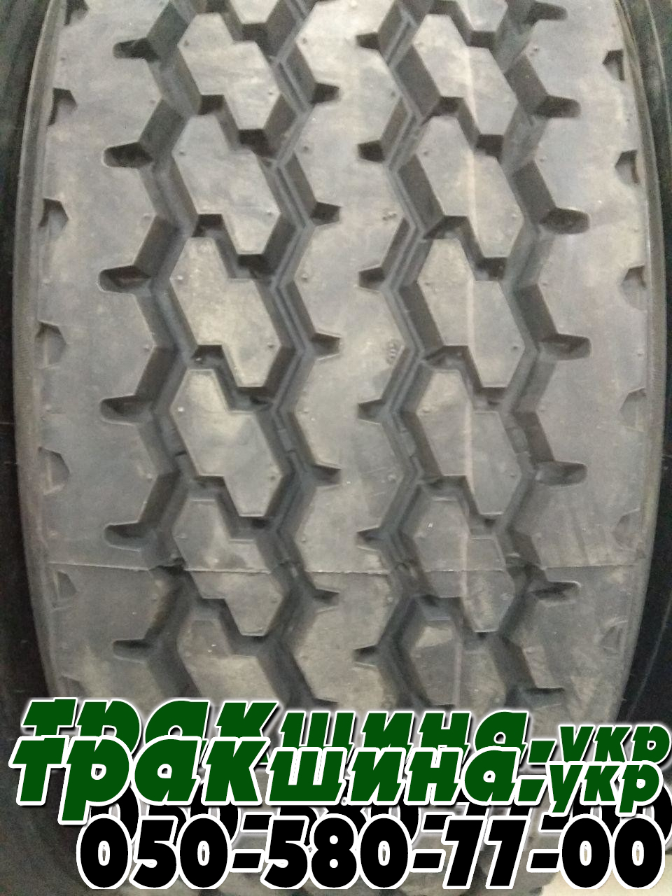 На фото шина photo-of-chinese-tire-protector-for-semi-trailer